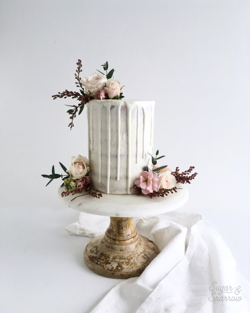 semi naked drip cake by sugar and sparrow