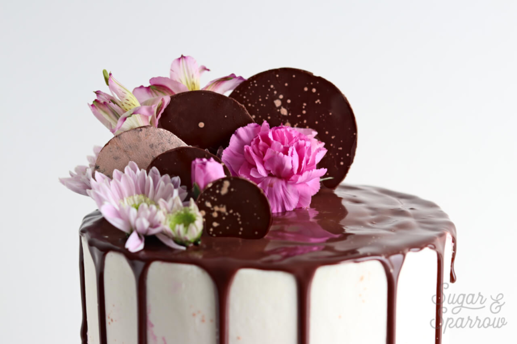 decorating cake with chocolate shapes