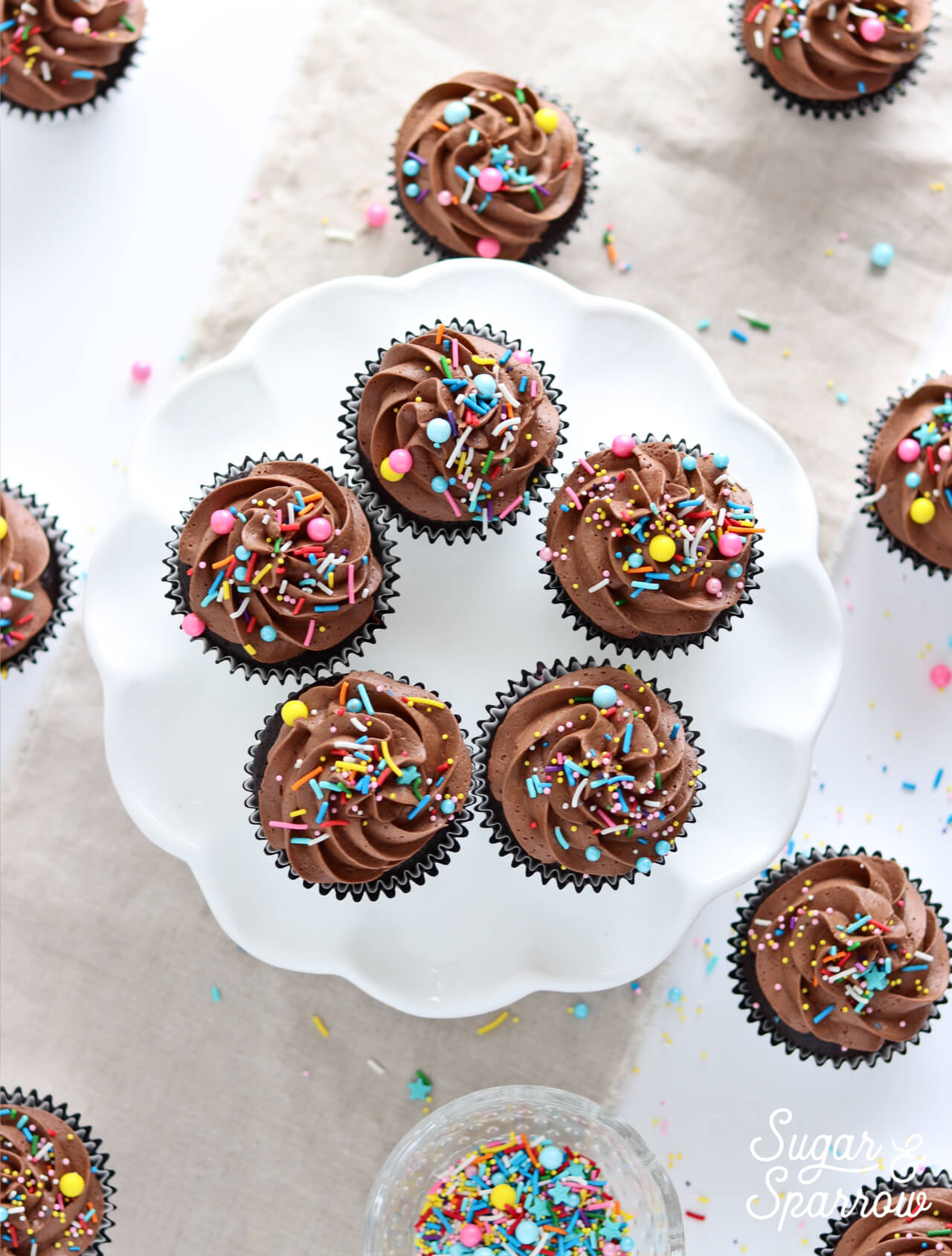 chocolate cupcakes with chocolate buttercream by sugar and sparrow