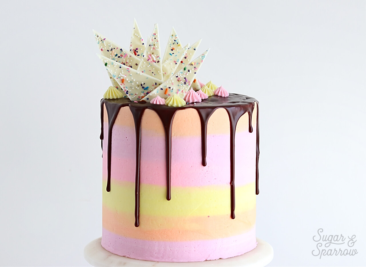 striped buttercream cake tutorial by sugar and sparrow