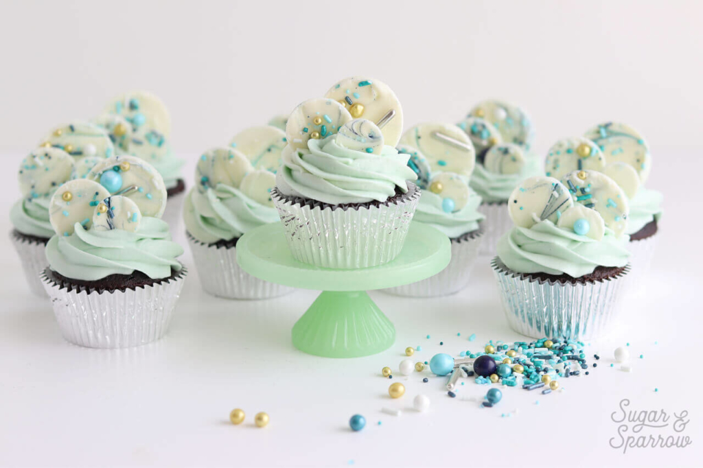 sprinkled white chocolate cupcakes by sugar and sparrow