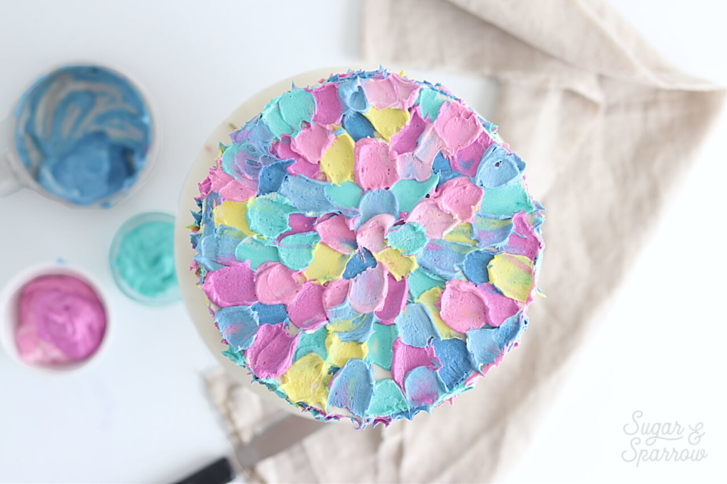 spatula painted buttercream cake by sugar and sparrow