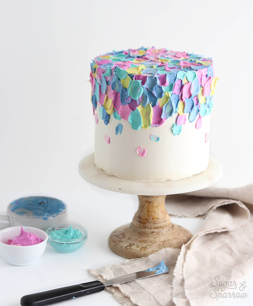 painted buttercream cake by sugar and sparrow