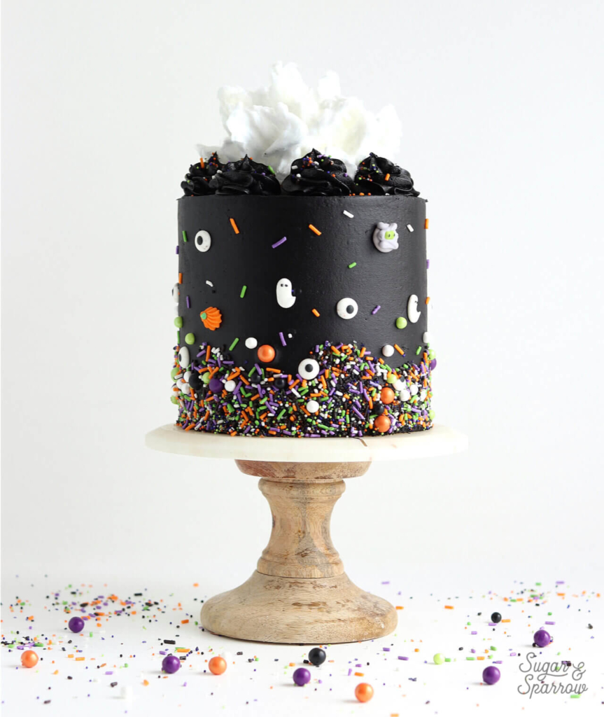halloween cake with black buttercream and sprinkles