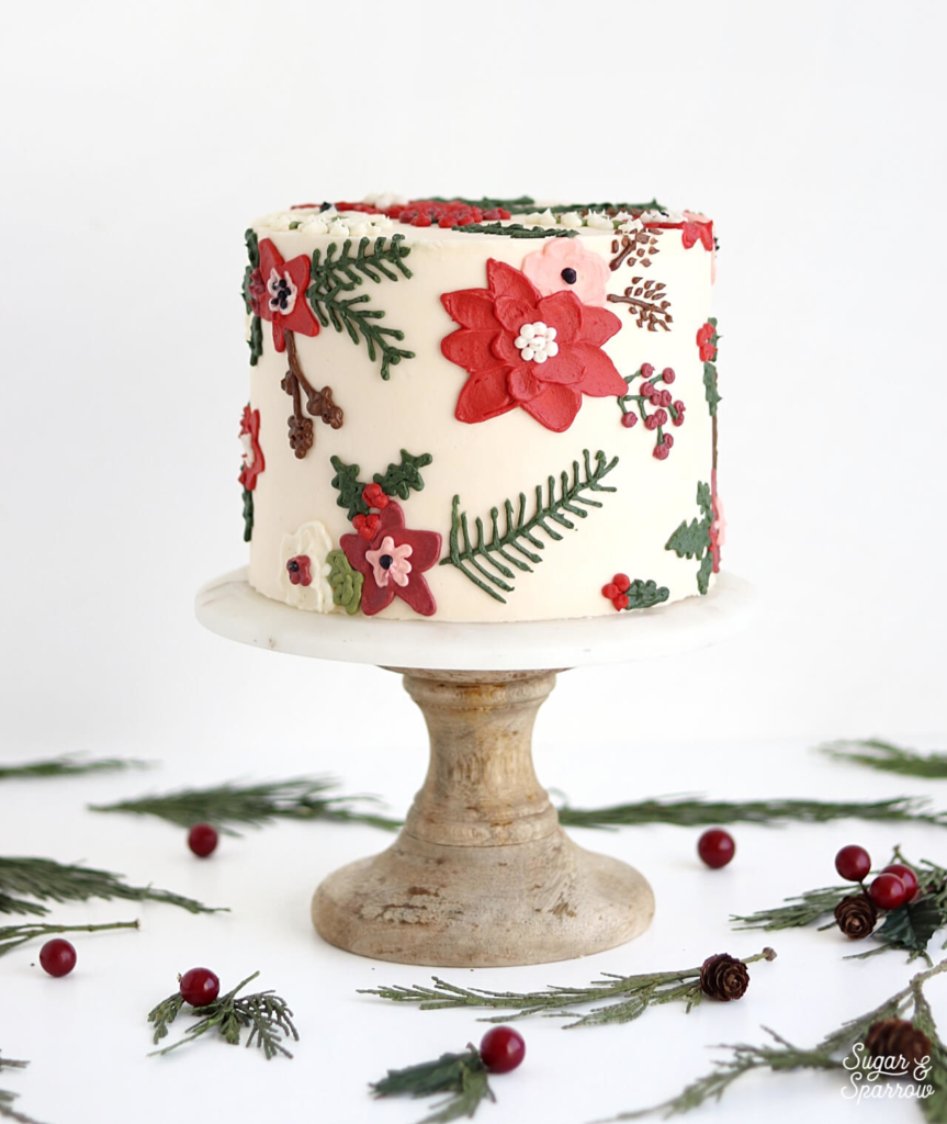 christmas floral cake by sugar and sparrow