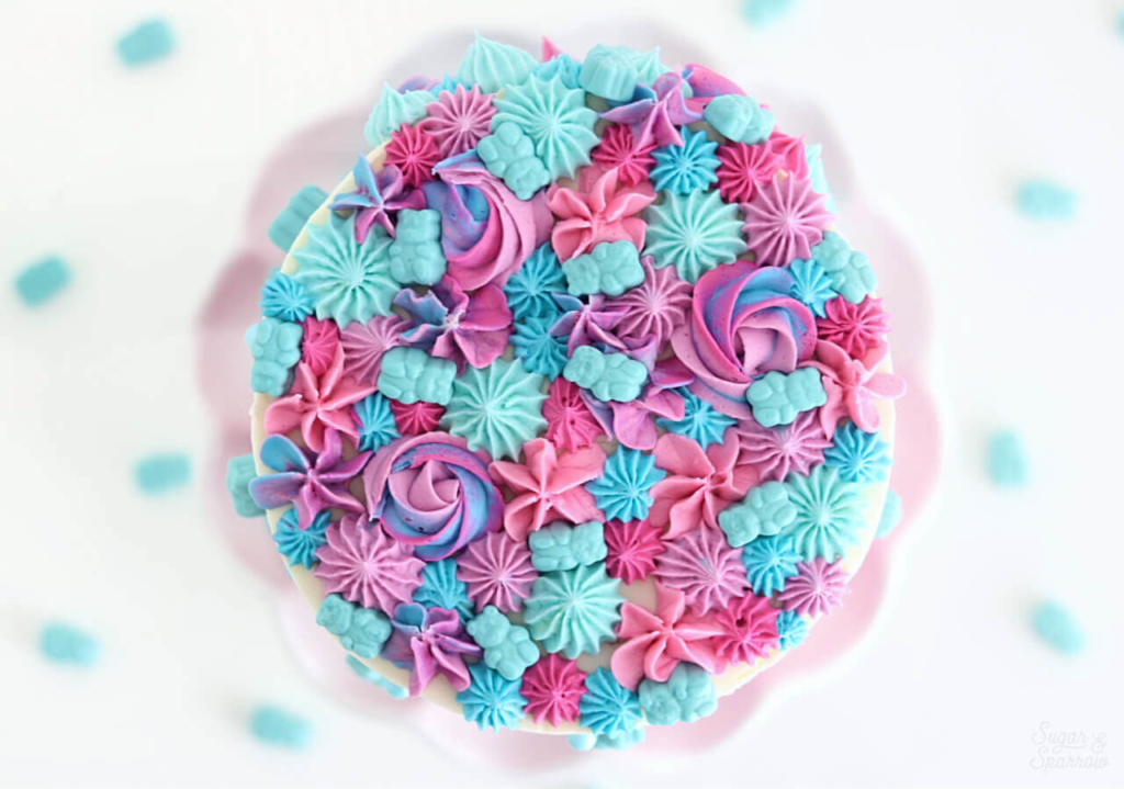 pink and blue cake by sugar and sparrow