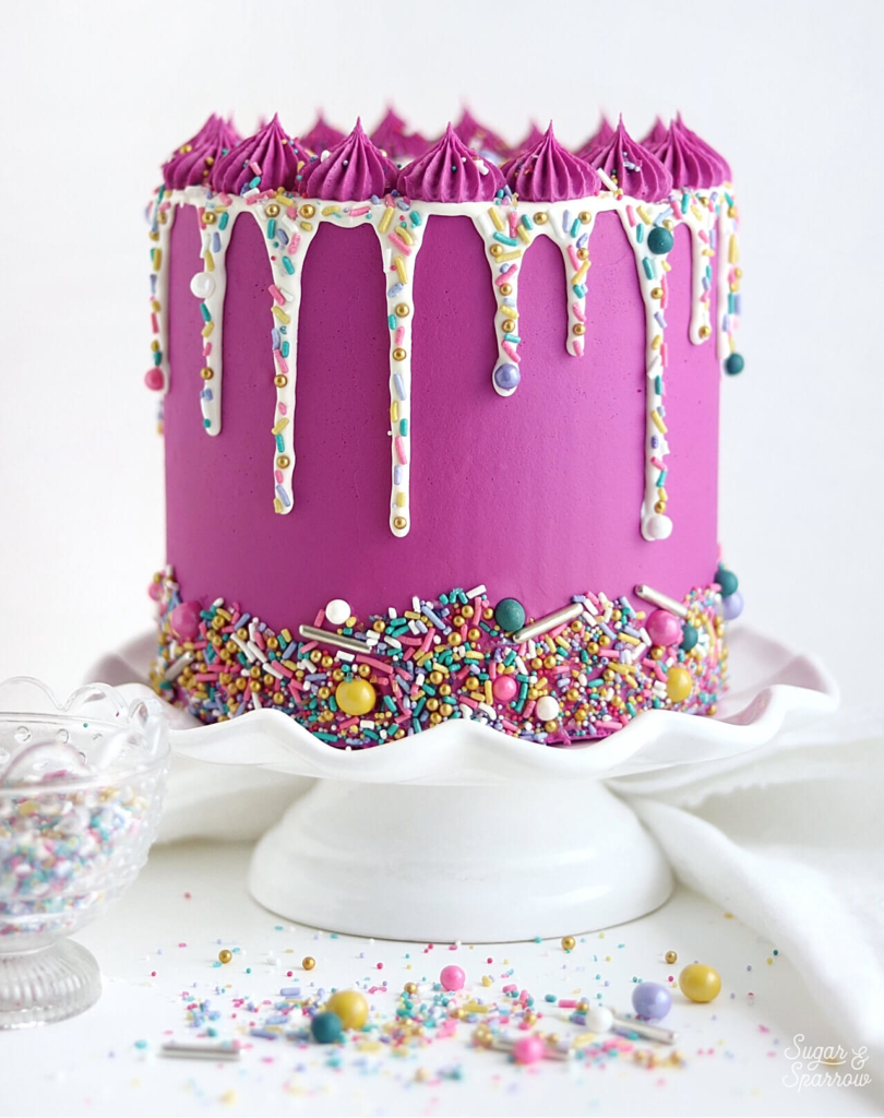 add sprinkles to ganache drip cake