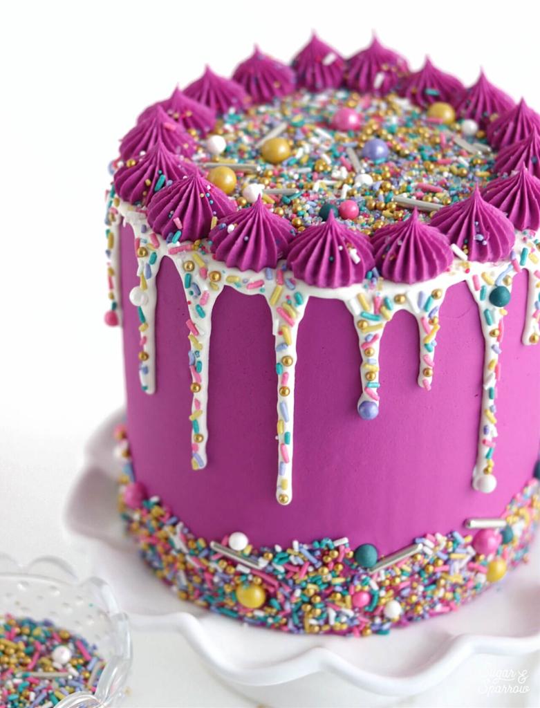 sprinkle drip cake by sugar and sparrow