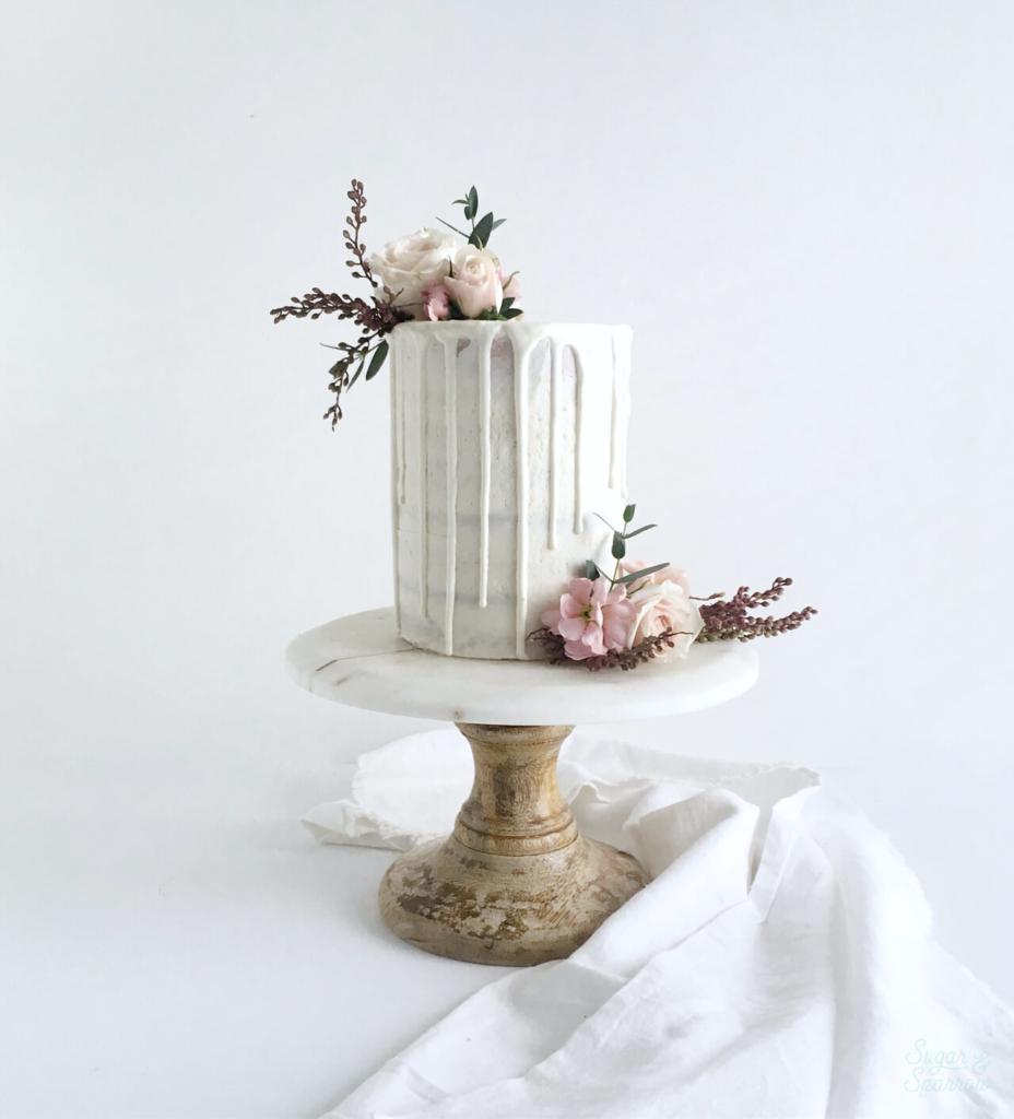 semi naked smash cake with white chocolate ganache drip