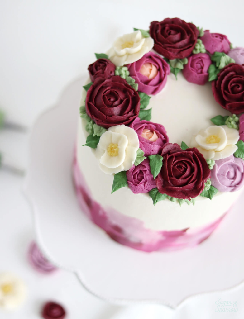 buttercream flower wreath cake by sugar and sparrow