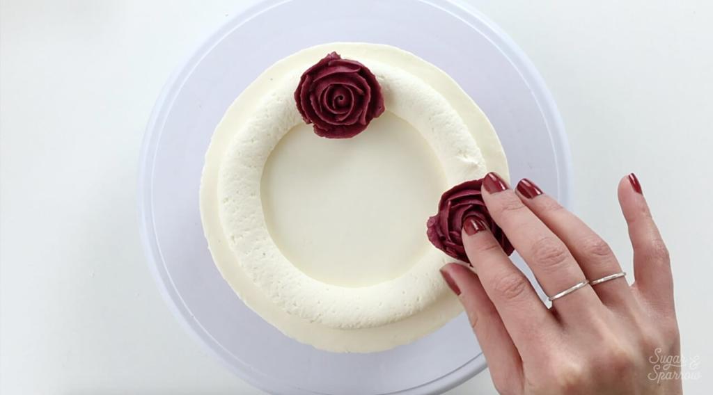 how to arrange buttercream flowers on cake