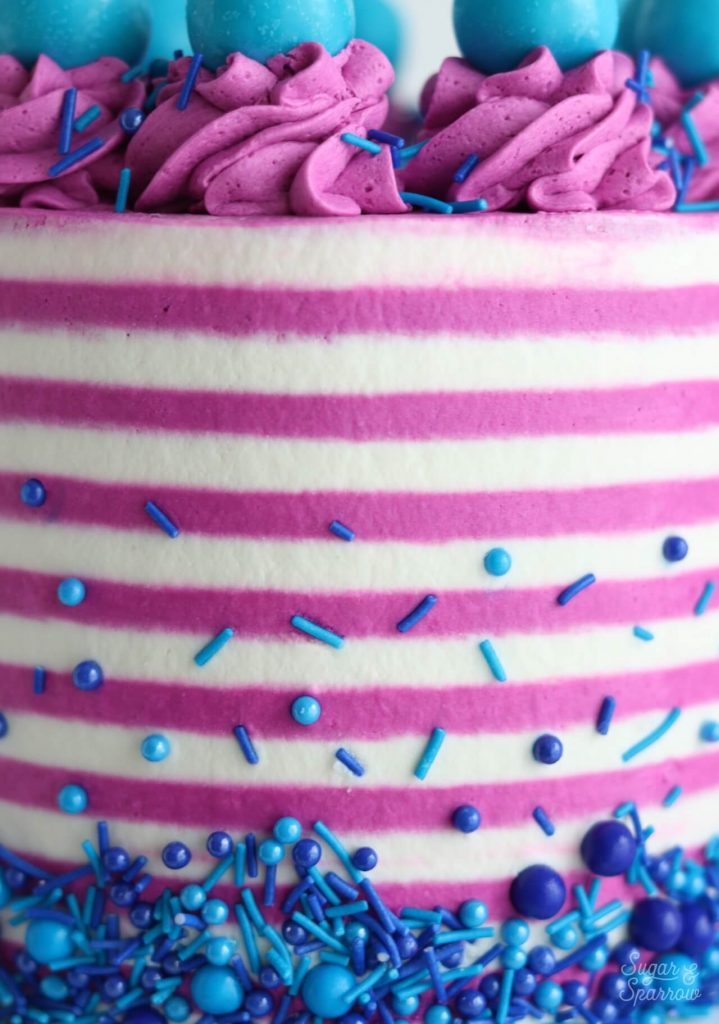 striped buttercream cake with sprinkles