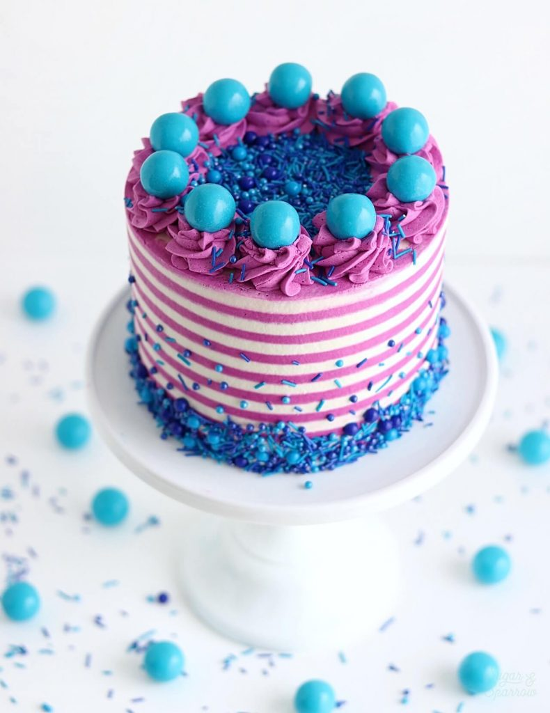 striped cake with sprinkles and gum balls
