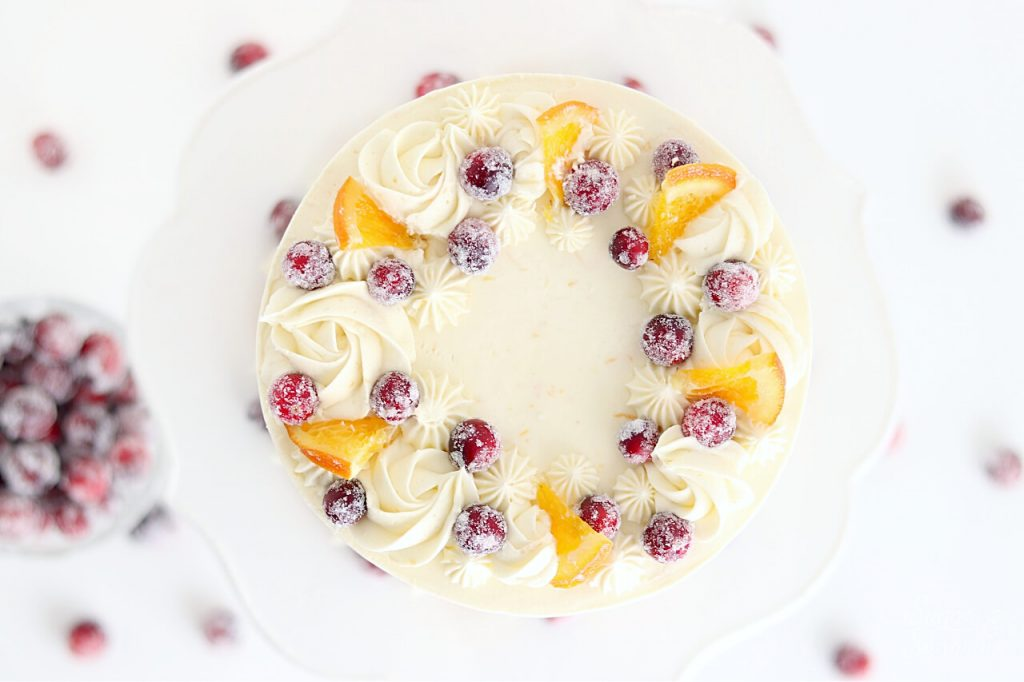 piped buttercream cake with cranberries and oranges