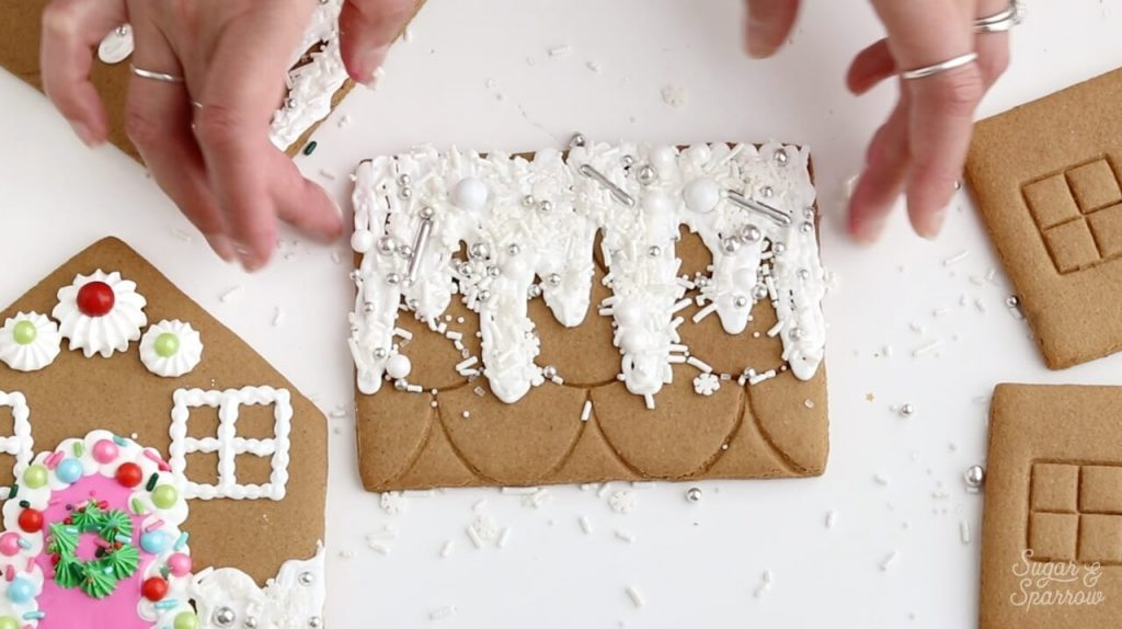 snow on gingerbread house