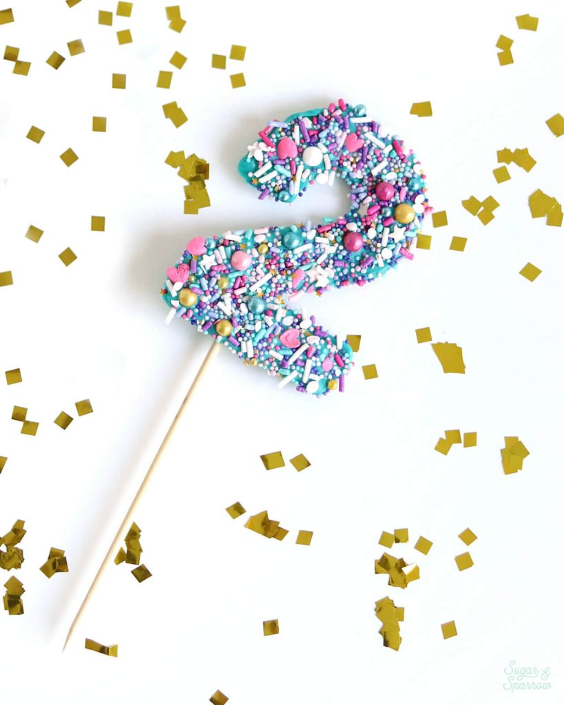 how to make your own cake topper number with chocolate and sprinkles