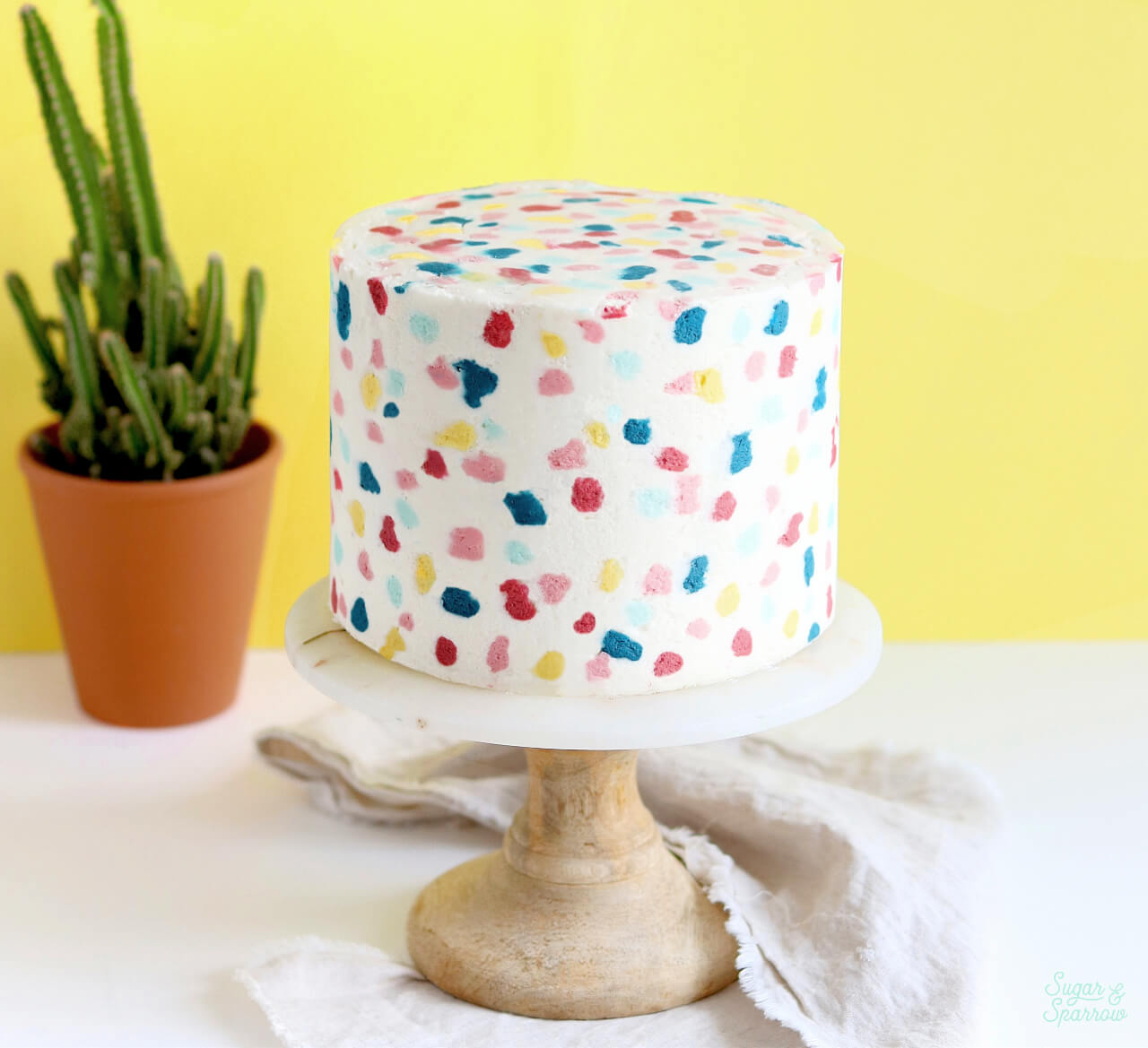 buttercream terrazzo cake by sugar and sparrow