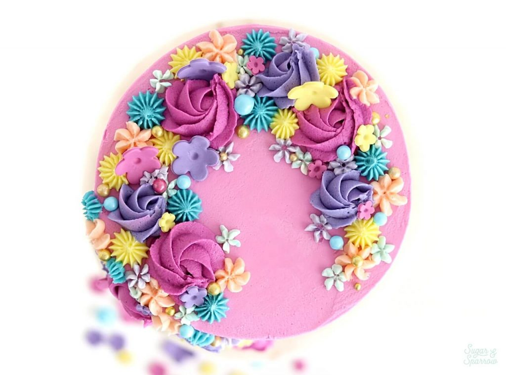 cake with flowers by sugar and sparrow