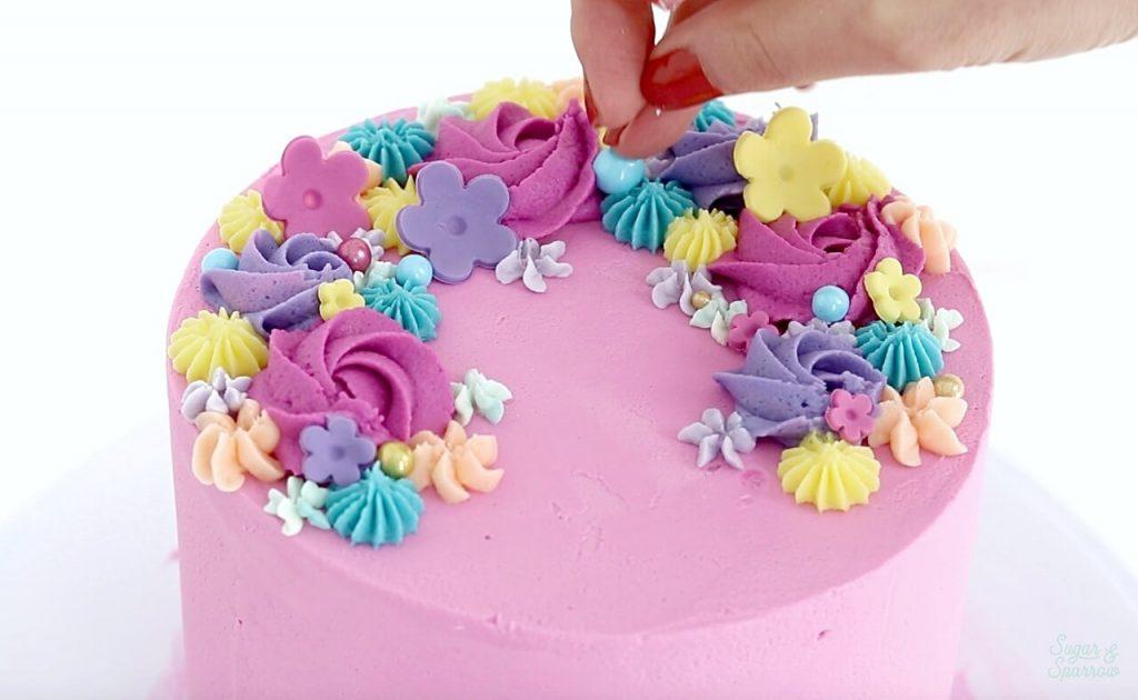 adding sprinkles to cake