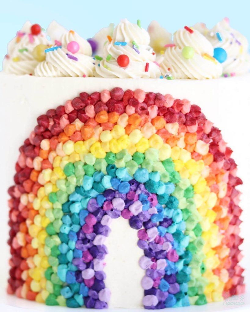 buttercream rainbow cake by sugar and sparrow