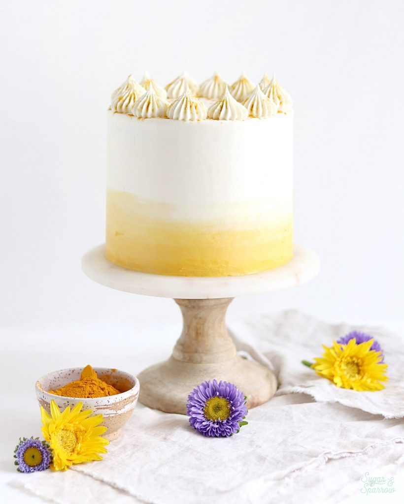turmeric layer cake recipe with coconut buttercream by sugar and sparrow