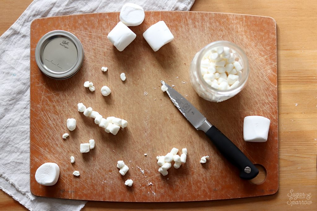 decorating a cake with marshmallows