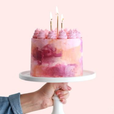 pink watercolor cake by sugar and sparrow