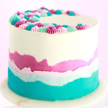 layered ombre buttercream cake by sugar and sparrow